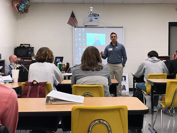 Dr. Joey Ibrahim speaks to a class.