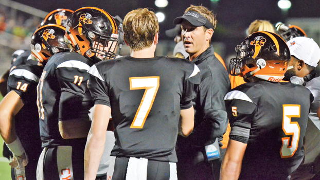 File Photo/Ivan Sanders Cyclone head coach Shawn Witten talks with his players during a timeout against Tennessee High earlier in the season.